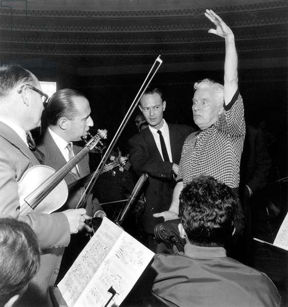 Charlie Chaplin in Paris Directing Conducting Musicians during Recording of Music For his Film A King in New York June 21, 1957 (b/w photo)