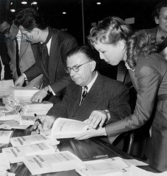 Writer Jean Paul Sartre and Cecile Aubry at Book Fair in Paris October 24, 1953 (b/w photo)