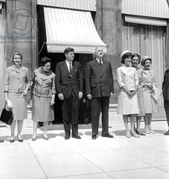 American President John Kennedy and his Wife Jackie in Paris here at Elysee Palace With French President De Gaulle and his Wife Yvonne May 31, 1961 , Jackie Wearing Alaskine (Wool and Silk) Created By Oleg Cassini, Pillbox Hat Created By Roy Halston Frowick (b/w photo)