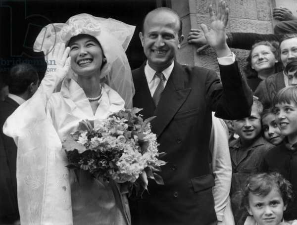 The Japanese Actress Keiko Kishi and the French Director Yves Ciampi at Their Marriage, France, May 4, 1957 (b/w photo)