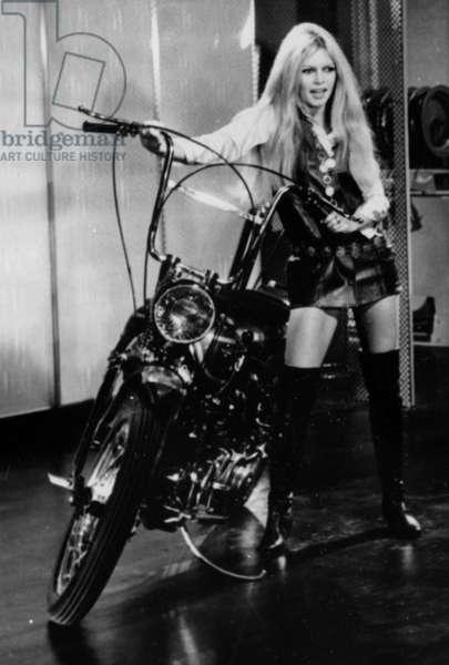 Brigitte Bardot during A TV Programme on December 29, 1967 (She'S Got Boots By Roger Vivier) (b/w photo)