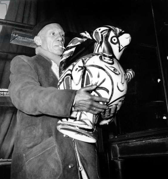 Artist Pablo Picasso Holding One of his Ceramics during Exhibition of his Works in Paris November 24, 1948 (b/w photo)