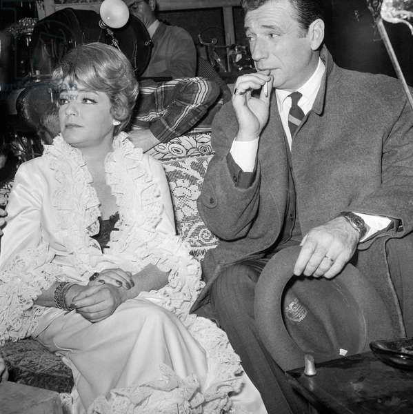 "Simone Signoret and Yves Montand on set of film ""The Sleeping Car Murders"" December 1, 1964 (b/w photo)"