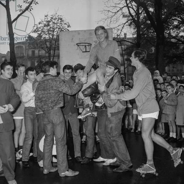 "Young rollers skaters from Carnot high school in Paris, after a demonstration to the young ""blousons noirs"", October 23, 1960 (b/w photo)"