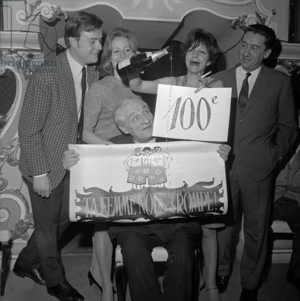 French actor Michel Vocoret, actress Christiane Oscar, actor Jean Tissier, actress Maria Pacome and actor and cabaret artist Jean Raymond celebrating the 100th performance of play 'Ta femme nous trompe' at the Theatre des Capucines in Paris, on March 15, 1966