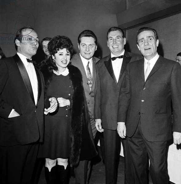 At the Gala Perce Neige, Les Accordeonistes Marcel Azzola, Yvette Horner, Andre Verchuren, Andre Duleu And Le Presenter Pierre Louis. December 7, 1967 At the Palais De Chaillot. Neg C 76301 (b/w photo)