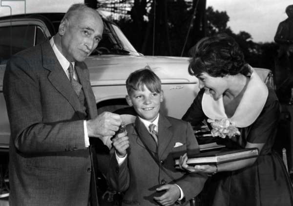 The 35000000Eth Visitor Of The Eiffel Tower A Young Rouennais Julien Bertin Here Receiving From Mr Legrain-Eiffel (Little Sons Of The Builder) The Keys Of A Car And Claudie Laurence A Book Relating The History Of The Celebre Tour June 30, 1959 (b/w photo)