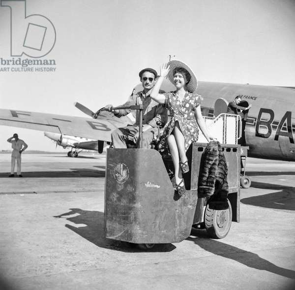 Aviation show, Paris, June 14, 1951 : Air France is organizing short flights over Paris, here French actress Paulette Dubost  at Orly airport after flight from Le Bourget (b/w photo)