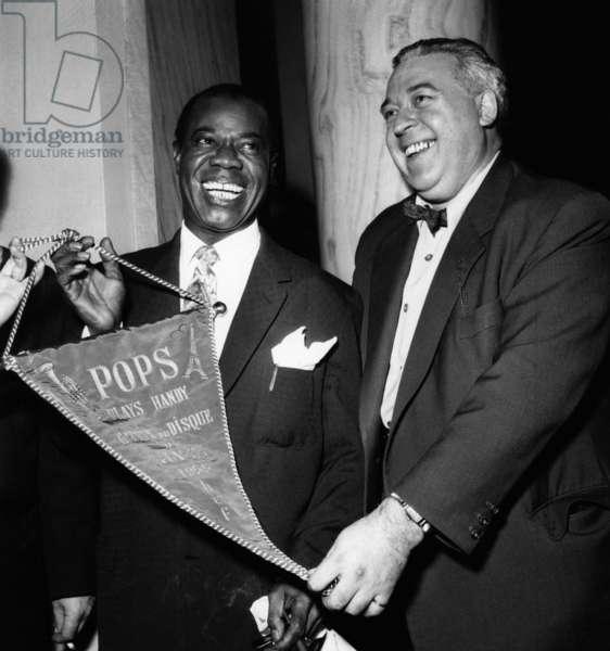 Jazzman Louis Armstrong Receiving A Prize (