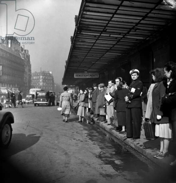 Sncf on Strike : People Waiting For A Truck at Montparnasse Station in Paris, September 24, 1948 (b/w photo)