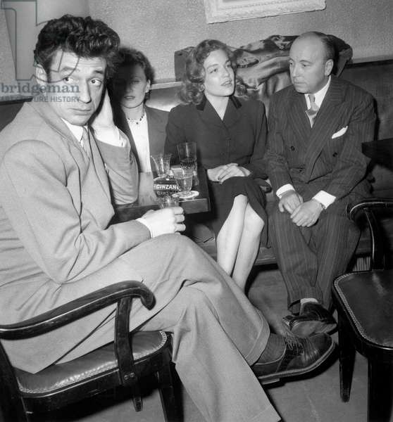 """Yves Montand , Simone Signoret and Director Marcel Carne at Presentation of Film """" La Marie Du Port """" March 14, 1950 (b/w photo)"""