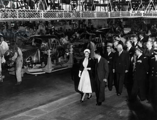 Queen Elizabeth Ii of England Visiting Renault Car Factory in Flins, France, on April 10, 1957 : here Looking at Assembly Line of Dauphines With Pierre Dreyfus (Chairman of Dauphines) (b/w photo)