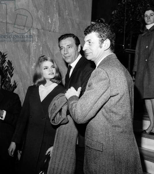 """Catherine Allegret, Yves Montand and Yves Robert at premiere of film """"Monnaie de singe"""", in Paris, March 9, 1966 (b/w photo)"""