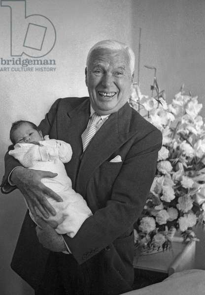 Charlie Chaplin with his son Christopher at Montchoisi clinic, Lausanne, Switzerland, July 13, 1962 (b/w photo)