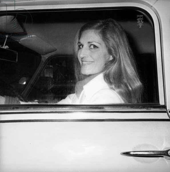 Singer Dalida, Driving An Austin Mini Car, Leaving Olympia in Paris After Rehearsal, January 14, 1974 (b/w photo)