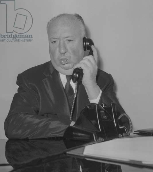 American director Alfred Hitchcock arriving at Orly airport in Paris, on October 1, 1960 (b/w photo)