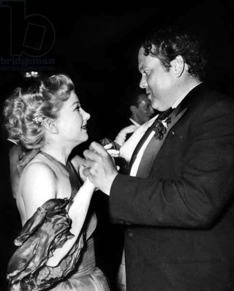 Orson Welles and Anne Baxter at Cannes Film Festival in 1955 (b/w photo)