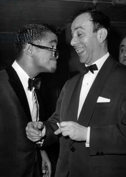 After Sammy Davis Junior One Man Show At Olympia, Fernand Raynaud came to Feliciter for his performance. They couldn't stop getting ready for a Desopilant Grimace Competition. March 13, 1964 (b/w photo)