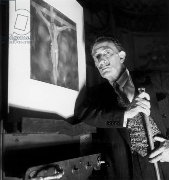 Salvador Dali in Paris on May 10, 1965 Presenting Illustration of The Christ (b/w photo)