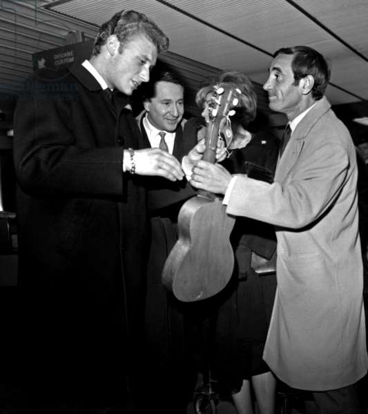Singer Johnny Hallyday Greeting Charles Aznavour in Paris Airport After his Trip in South America November 03, 1962 (b/w photo)