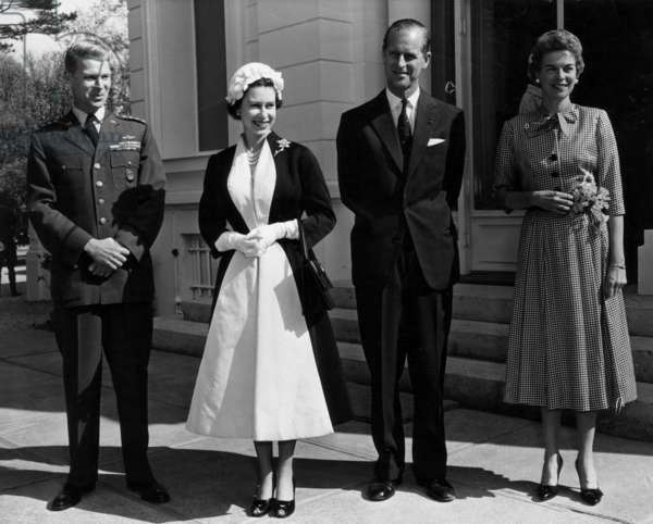 Queen Elizabeth II of England and Prince Consort Philip Duke of Edinburgh during their Visit in France with General Lauris Norstad and his Wife in Marnes-La-Coquette, April 8, 1957 (b/w photo)