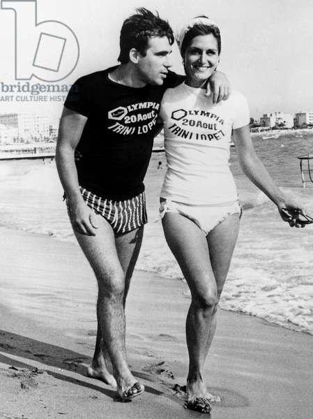 Singers Dalida and Claude Nougaro Wearing Advert Tshirt Tee Shirt Tee-Shirt For Singer Trini Lopez August 17, 1964 (b/w photo)