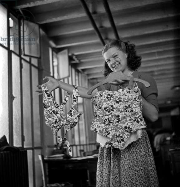 Making of Clothes (Her Swimming Suit) With Plane Canvas, Paris, C. 1947 (b/w photo)