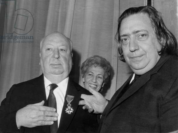 Alfred Hitchcock Receiving The Legion of Honour From Henri Langlois, Manager of French Film Archive on January 15, 1971 (b/w photo)