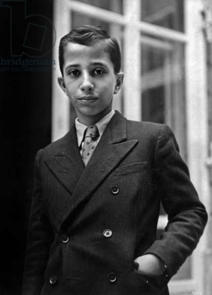 The Young King Fay¿Al II of Iraq Arriving In Paris Here At His Hotel On September 24, 1946 (b/w photo)