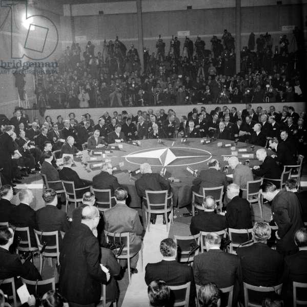 Nato Summit in Paris (Chaillot) on December 16, 1957 : on R : Harold Macmillan, David Dwight Eisenhower, Paul-Henri Spaak, Joseph Bech (Luxemburg), Achille Van Acker (Belgium), John Diefenbaker (Canada), Eric Ninn-Hansen (Denmark), Felix Gaillard (France), Conrad Adenaue (Germany), Constantine Karamanlis (Greece) (b/w photo)