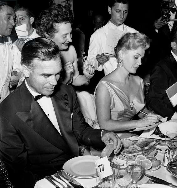 The Yearly Gala Evening of The Monegasque Red Cross on The Terrace of The Monte Carlo Sporting Club : Zsa Zsa Gabor and Porfirio Rubirosa Autographing August 1, 1955 Neg A 10992 (b/w photo)