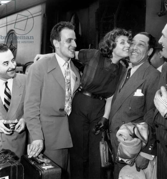 Duke Ellington Arriving at Paris Northern Railway Station, here Greeted By Boris Vian and Christophine July 19, 1948 (b/w photo)