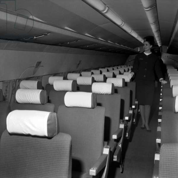Stewardess in An Air France Caravelle, at Orly Airport, Paris, March 9, 1965 (b/w photo)