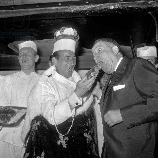 The French pastry cook Jean Delaveyne (c) is elected 1962 prince of the pastry cooks, France, May 9, 1962. On r : Jean Rigaux (b/w photo)