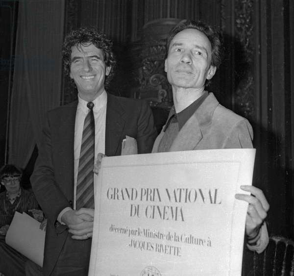 """French director Jacques Rivette has received from French minister of culture Jack Lang a prize (""""Grand Prix International du Cinema""""), Paris, December 18, 1981 (b/w photo)"""