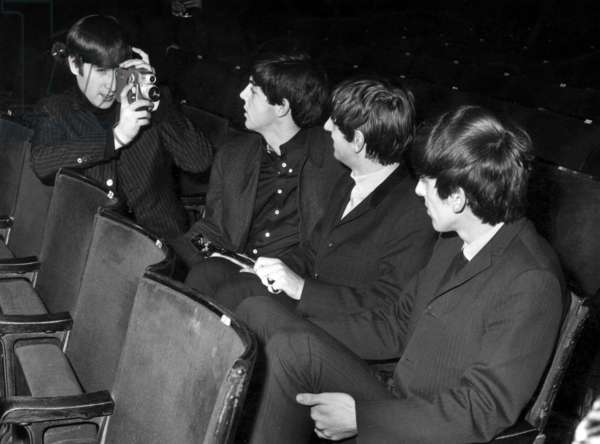 John Lennon films the other members of The Beatles: Paul McCartney Ringo Starr and George Harrison, before the show in The ABC Cinema in Belfast,  November 1963 (b/w photo)