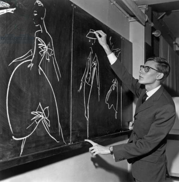 Yves Saint Laurent Drawing on Blackboard Models, November 16, 1957 (b/w photo)