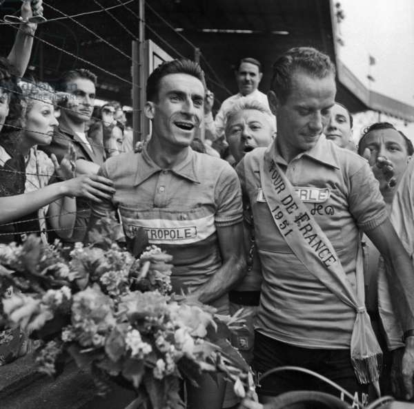 Hugo Koblet and Raphael Geminiani at Arrival of Tour De France in Paris on July 29, 1951 (b/w photo)