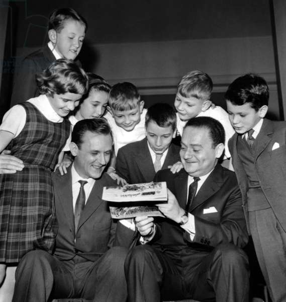 Draughtsmen Albert Uderzo and Rene Goscinny With Group of Children during Childhood Publishing Prize November 16, 1962 (b/w photo)