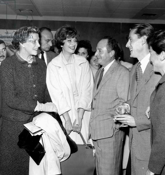 French Painter Bernard Buffet at Orly Airport For Departure For Texas With L-R : Louise De Vilmorin, Model Marie-Helene Arnaud, Pierre Daminos, Bernard Buffet and Lisette Pariente on October 13, 1957 (b/w photo)