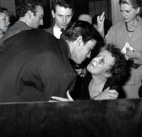 French Actor Alain Delon Congratulating French Singer Edith Piaf After her Show in Melun (First Show After her Operation) on November 21, 1959 (b/w photo)