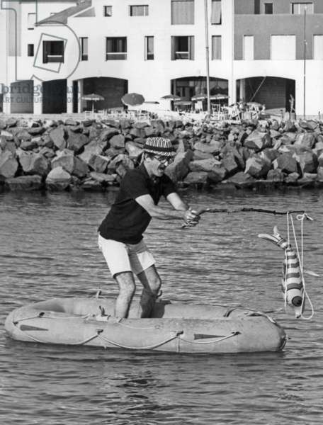 Marcel Zanini on A Rubber Dinghy during his Holidays in Cap D'Agde, France, July 29, 1971 (b/w photo)