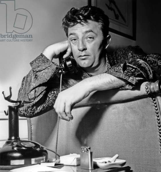 Robert Mitchum in Parisian Hotel Before Going To Cannes Film Festival March 22, 1954 (b/w photo)