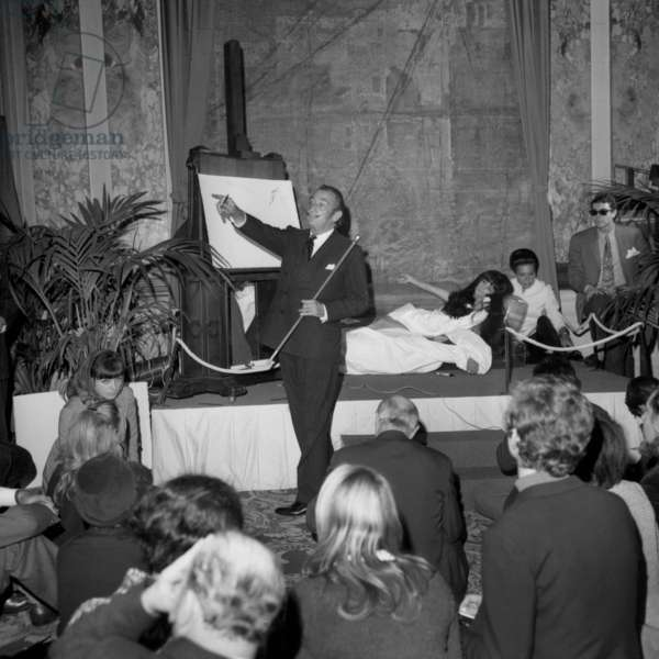 Salvador Dali Giving A Drawing Lesson at Hote Meurice in Paris on November 7, 1967 (b/w photo)