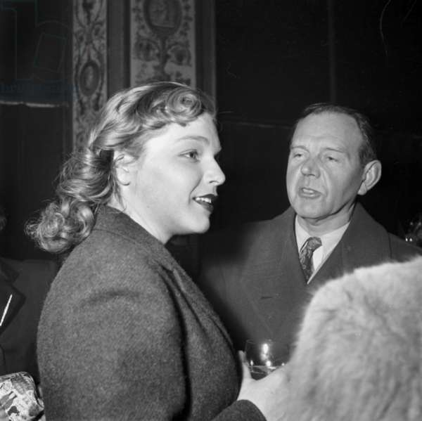 "Actors Simone Signoret and Fernand Ledoux at Cocktail Given For Film ""Jean De La Lune"" in Paris, January 12, 1949 (b/w photo)"