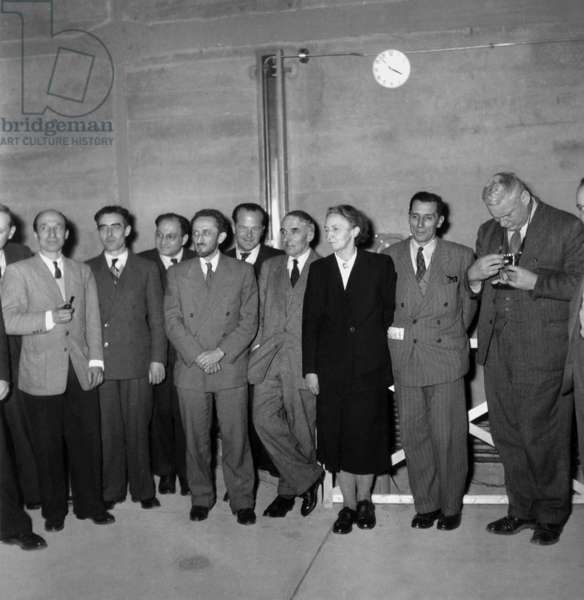 Physicists Lew Kovarski , Raoul Dautry, Frederic Joliot Curie, Francis Perrin, Maurice Surdin and Irene Joliot-Curie on December 20, 1948 For Presentation of Nuclear Battery (b/w photo)