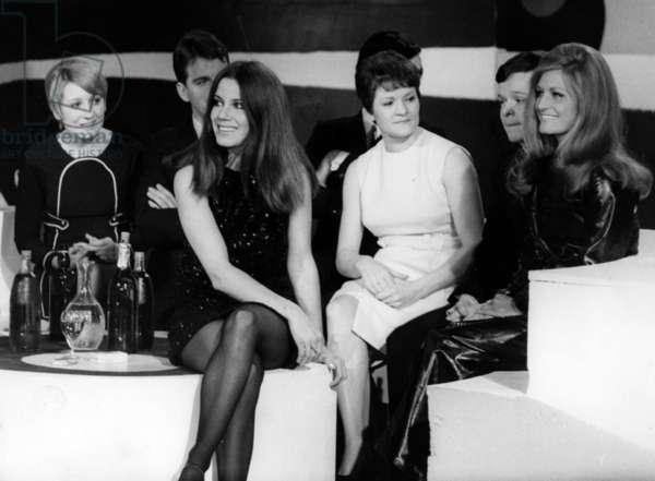 "French Announcer Noelle Noblecourt Wearing Mini Skirt during TV Programme ""Tele Dimanche"" on February 2, 1969 ; on R : Dalida (b/w photo)"
