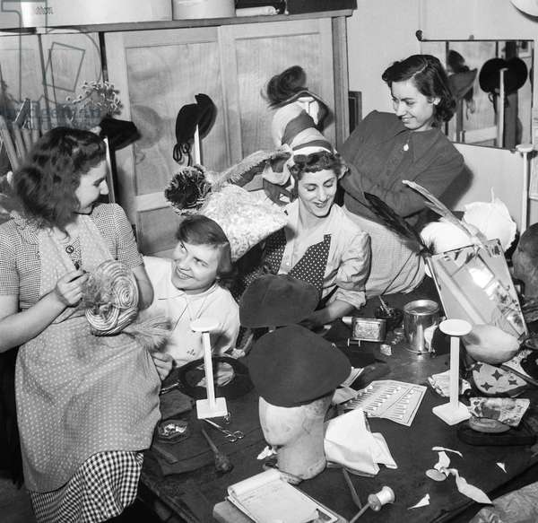 "The ""Catherinettes"" : young women preparing the Saint Catherine at Emma Pierron fashion house, Paris, November 15, 1950 (b/w photo)"