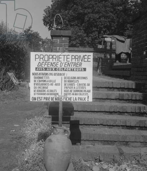 In Normandy, France, the owner of a house has put a board against pedlars, he doesn't want to be disturbed and needs nothing, September 13, 1960 (b/w photo)