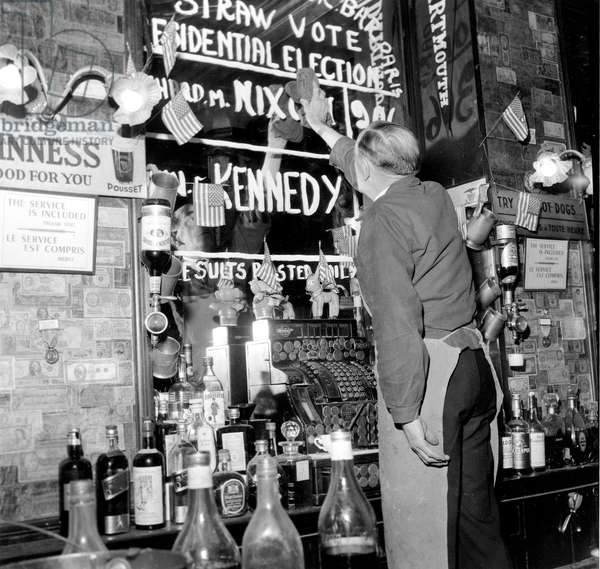 After Kennedy Won Presidential Elections The Name of Nixon, Winner of A Straw Vote, Is Erased Rubbed Out From The Walls of Harry'S Bar, Paris Where Americans Followed Elections November 9, 1960 (b/w photo)